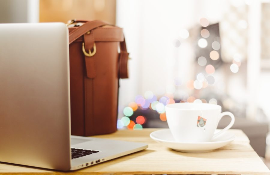 laptop with bag and coffee