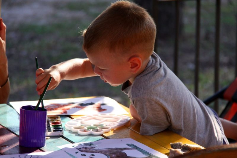 kid painting in nursery